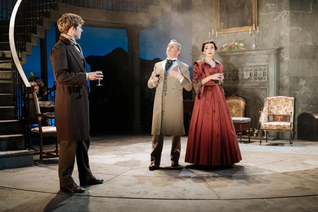 My cousin Rachel tour - revolving stage company provides 8m stage for the play. News image showing 3 actors standing on stage.