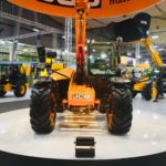 JCB on a revolving stage display at and exhibition.