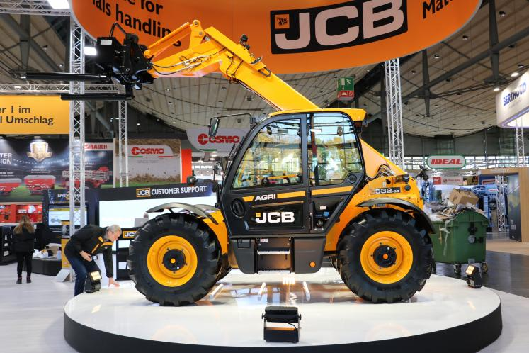 JCB on a revolving stage at exhibition.